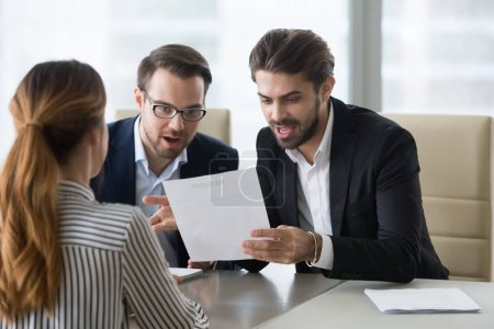Photo for Surprised funny human resources managers reading resume of best applicant ever. Suitable candidate for vacancy. Smiling recruiter, employer. Successful job interview, hiring, staff recruiting process. - Royalty Free Image