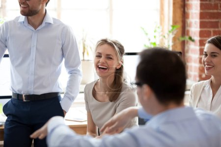 Photo for Happy laughing businesswoman at briefing, company meeting with group, team colleagues, office workers brainstorming together, discussing funny news, celebrating good results, good relationships in - Royalty Free Image