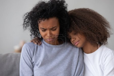 Photo for African American teenage daughter hug sad depressed mom, crying having life problems, caring black teen girl embrace disappointed mommy or nanny, show love and support. Best friends concept - Royalty Free Image