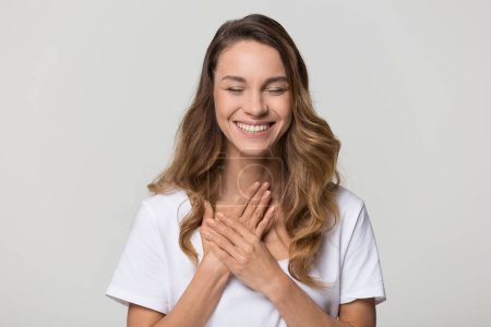 Happy pleased young woman thanking for care feel g...