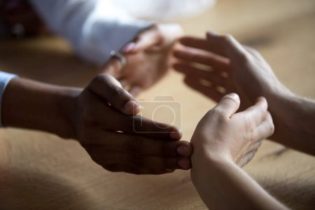 Photo for Close up diverse business people join hands forming circle, show unity and support, protection of business, multiracial colleagues involved in team building activity, help in teamwork concept - Royalty Free Image