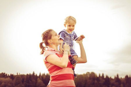 Mom throws a son in the sky. The concept of pleasu...