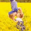 Funny kids kissing in the field at sunset. The con...