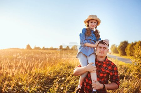Photo for Happy father and daughter walking on summer meadow, having fun and playing. Father's day, fatherhood concept. Rural living. - Royalty Free Image