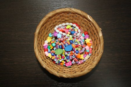 Photo for Beads on a wooden basket - Royalty Free Image