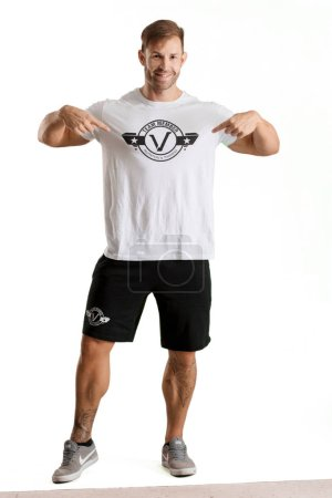 Photo for Young handsome bodybuilder man posing with muscular appearance - Royalty Free Image