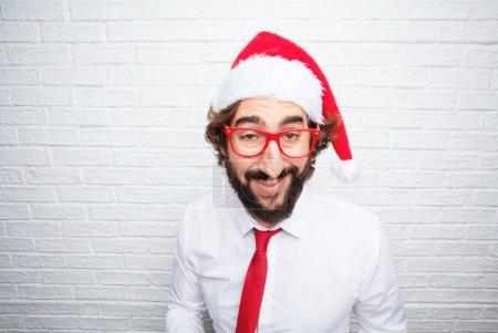Photo pour Un jeune homme qui gesticule. Concept de Noël . - image libre de droit