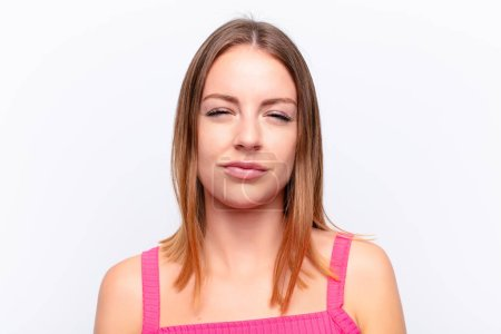 Photo for Red head pretty woman feeling displeased and disappointed, looking serious, annoyed and angry with crossed arms - Royalty Free Image