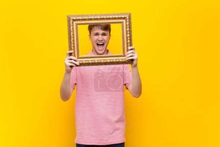Photo for Young blonde man with a baroque frame - Royalty Free Image