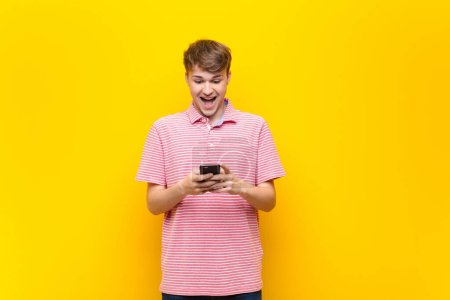 Photo for Young blonde man with a smartphone mobile - Royalty Free Image