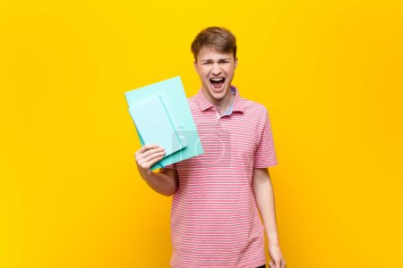 Photo for Young blonde man with book - Royalty Free Image