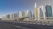 """Постер, картина, фотообои """"Вид озера Jumeirah башни небоскребы и метро sration timelapse hyperlapse с движением на Шейх Заид Роуд и трамвай линии. Солнечный день с голубым небом"""""""