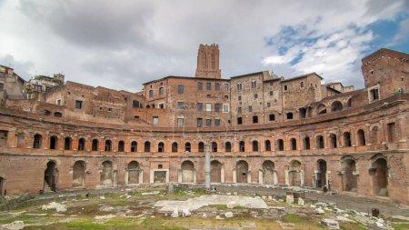 A panoramic view on Trajan's Market timelapse hyperlapse (Mercati Traianei) on the Via dei Fori Imperiali, in Rome, Italy. Clody sky