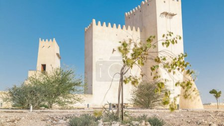 Barzan Towers timelapse, watchtowers in Umm Salal Mohammed near Doha - Qatar, the Middle East. Blue sky at sunny day