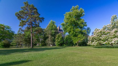Beautiful Medieval landmark - royal hunting castle Fontainbleau timelapse hyperlapse with green park. Palace of Fontainebleau - one of largest royal chateaux in France, UNESCO World Heritage Site.