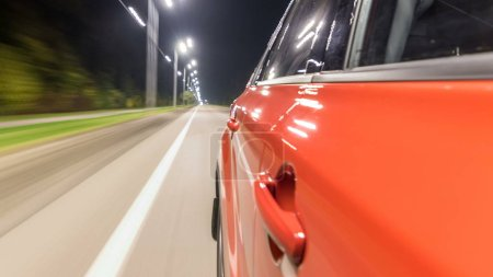 Photo for Drivelapse from Side of Car moving on a night highway timelapse hyperlapse, road with lights reflected on car on high speed. Rapid rhythm of a modern city. - Royalty Free Image