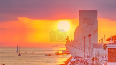 Photo for Elevated sunset view of the Padrao dos Descobrimentos (Monument to the Discoveries)  famous monument on the banks of the River Tagus in Lisbon with dark clouds and rain on background. - Royalty Free Image