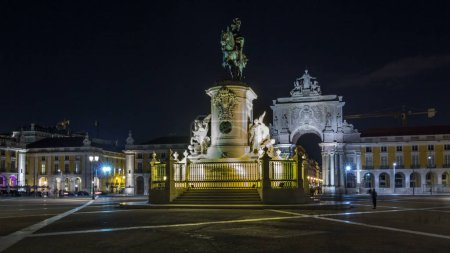 Photo for Triumphal arch at Rua Augusta and bronze statue of King Jose I at Commerce square illuminated at night   in Lisbon, Portugal. After the great 1775 Lisbon earthquake earthquake the square was completely remodeled. - Royalty Free Image