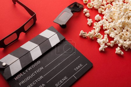 Photo for Movie background. Clapperboard, popcorn and 3D glasses on red backdrop, copy space - Royalty Free Image
