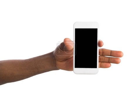 Photo for Hand holding mobile smartphone with blank screen, isolated on white background. Copy space for advertisement of mobile app, mockup - Royalty Free Image