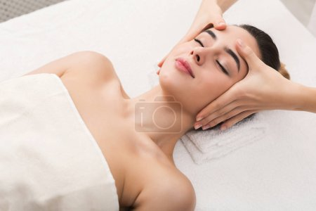 Photo for Facial massage. Spa, resort, beauty and health concept. Beautiful woman getting professional face treatment, copy space, closeup - Royalty Free Image