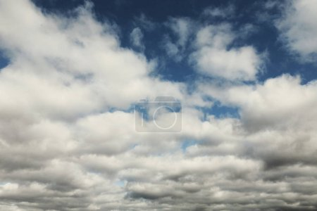 Photo for Autumn sky with white and gray fluffy clouds, natural background - Royalty Free Image