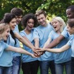 Happy young diverse volunteers preparing for work,...
