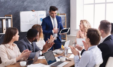 Photo for Business people applauding for colleague after presentation in office - Royalty Free Image
