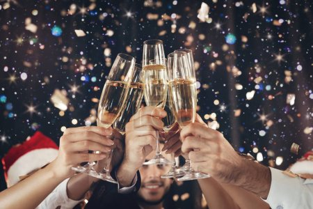 Photo for Happy New Year. Clinking glasses of champagne in hands on bright lights background - Royalty Free Image