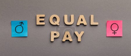 Photo for Equal Pay for man and woman, wooden words with gender symbols on gray background, panorama - Royalty Free Image