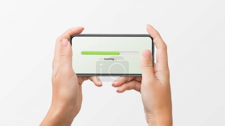 Photo for Womans hands holding smartphone with loading progress bar on white background. - Royalty Free Image