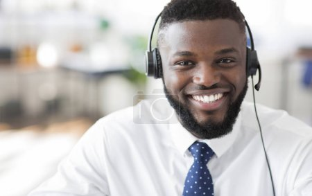 Portrait of cheerful african customer service representative with headset