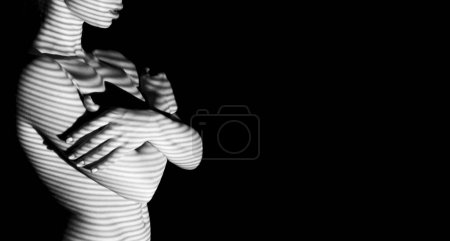 Photo for Naked sensual beautiful girl with stripped shadow pattern. Artistic black and white photo with copy space. - Royalty Free Image