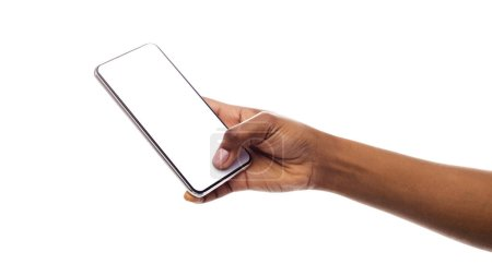 Photo for Afro womans hand holding mobile phone with blank screen isolated on white. Panorama with empty space - Royalty Free Image