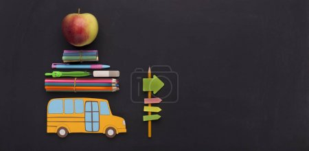 Photo for Yellow american school bus with stationery going by road signs to copy space, panorama - Royalty Free Image