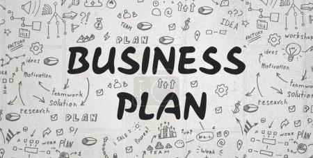 Photo pour Concept de stratégie. Le plan d'affaires écrit sur fond gris avec illustrations et dessins - image libre de droit