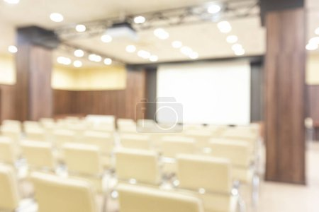Photo for Blurred photo of conference room from projector screen, bright light - Royalty Free Image