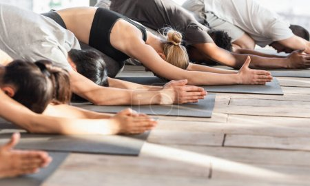 Young Fit People Practicing Yoga Together, Meditat...