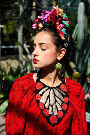 Portrait of gorgeous young woman in stylish floral headdress