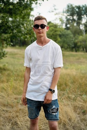 Photo for Handsome young guy in casual clothes posing outdoors - Royalty Free Image
