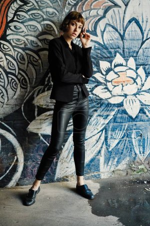 Young short haired woman in stylish black clothes posing