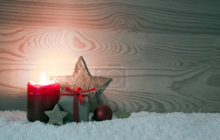 Christmas gift box and red Advent candle.