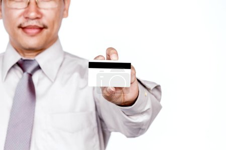 Photo for Businessman holding a credit card on white background - Royalty Free Image