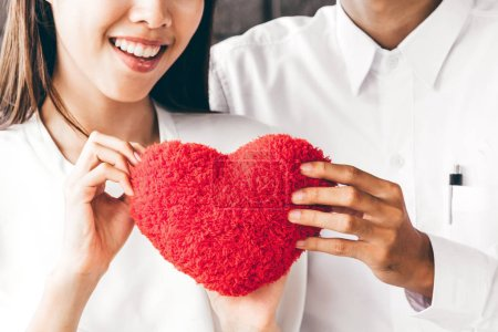 Photo for Man and woman holding red heart - Love concept - Royalty Free Image