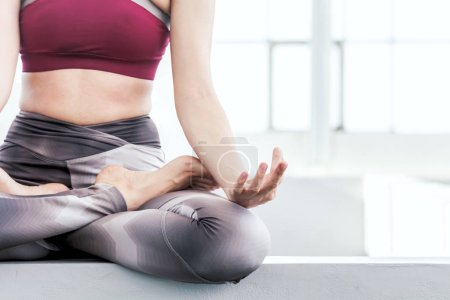 Woman practicing yoga in the park - Healthy lifestyle