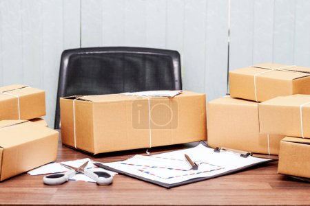 Photo for Cardboard box for delivery on wooden table - Royalty Free Image