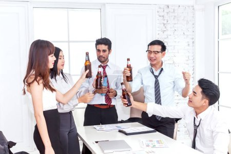 Photo for Group of business people professionals successful drink beers in office - Royalty Free Image
