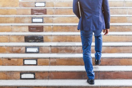 Photo for Businessman walking up the stairs - Royalty Free Image