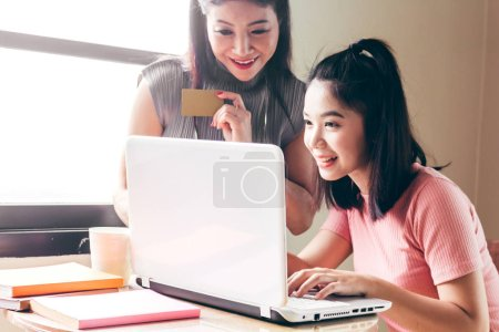 Photo for Woman holding credit card and using laptop - Online shopping concept - Royalty Free Image