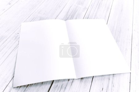 Photo for White blank paper magazine mockup on wooden table - Royalty Free Image